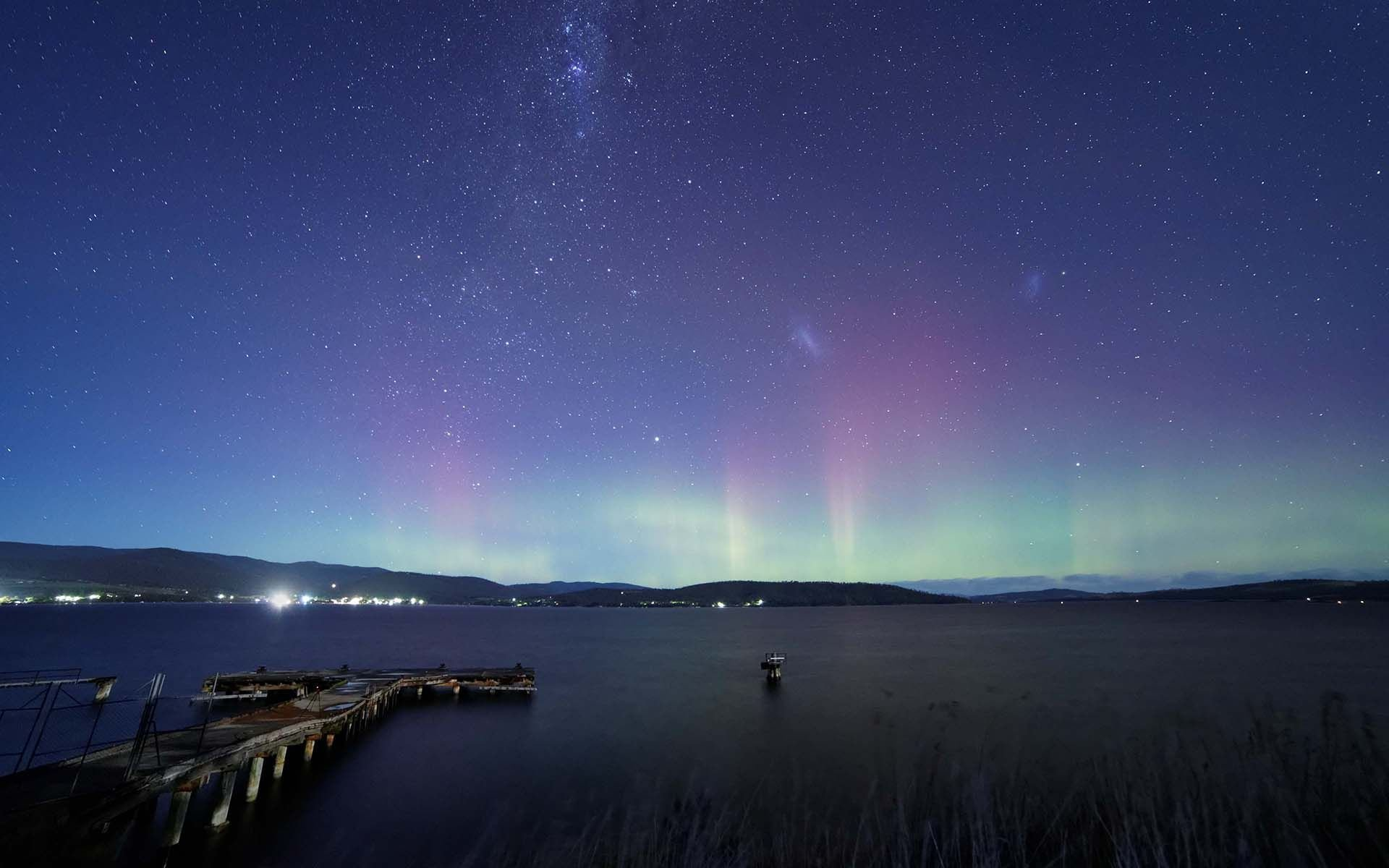 aurora borealis over the lake high definition wallpaper
